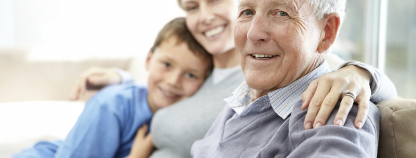 Closeup portrait of a senior man sitting with his daughter and grandson
