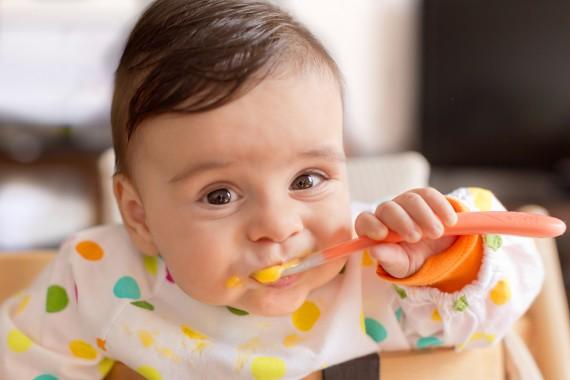 Baby boy eating pureed food
